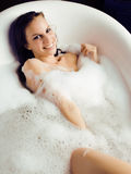 Young cute sweet brunette woman taking bath, happy smiling people concept Royalty Free Stock Image