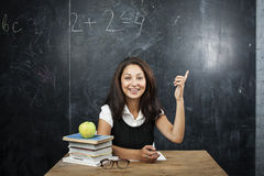 Young cute tanned teenage girl happy pointing, thinking, education concept Stock Image