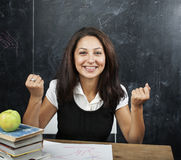 Young cute tanned teenage girl happy pointing, thinking, education concept Stock Images