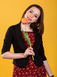 Young cute teen brunette girl with tulip Royalty Free Stock Photos
