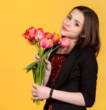 Young cute teen brunette girl with tulips Stock Image