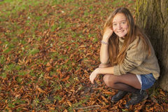 Young cute teen girl in autumn park. Nature. Stock Photos