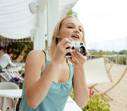 Young cute teenage girl with camera outside Royalty Free Stock Photos