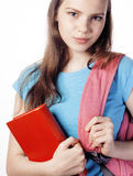 Young cute teenage girl posing cheerful against white background with books and backpack Royalty Free Stock Photo
