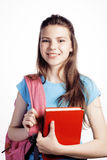 Young cute teenage girl posing cheerful against white background with books and backpack Stock Photos