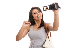 Young cute tourist recording video greetings. Isolated Stock Photos