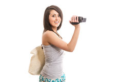 Young cute tourist with video camera. Isolated Stock Photos