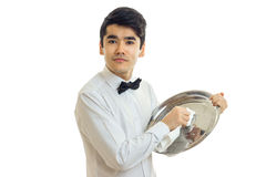 Young cute waiter rub towel tray for cupboards close-up Stock Images