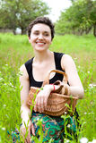 Woman with basket in the garden Stock Images