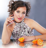 Young cute woman with citrus sitting Royalty Free Stock Image
