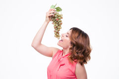 Young cute woman eating grapes Stock Images