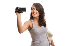Young cute woman filming Stock Images