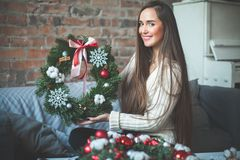 Young Cute Woman Florist with Christmas Tree Wreath Royalty Free Stock Photos