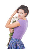Young cute woman with flowers Stock Images