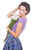 Young cute woman with flowers Stock Photos