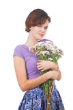 Young cute woman with flowers Royalty Free Stock Image