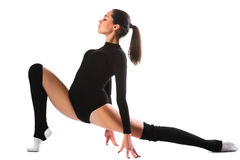 Young cute woman in gymnast suit show athletic skill on white background Stock Photography