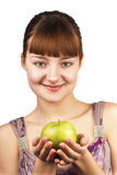 Young cute woman holding an apple. Over white background stock photo