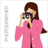 Young cute woman  holding the camera, while Royalty Free Stock Photography