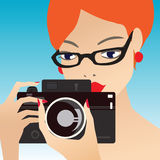 Young cute woman  holding the camera, while Royalty Free Stock Photo