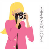 Young cute woman  holding the camera, while Stock Images