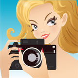 Young cute woman  holding the camera, while Royalty Free Stock Images
