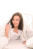 Young cute woman lying on bed Royalty Free Stock Photo
