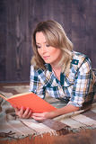 Young cute woman reading a book Stock Photo