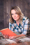 Young cute woman reading a book Stock Photography