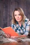 Young cute woman reading a book Stock Photos