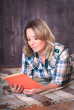 Young cute woman reading a book Stock Images