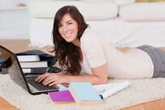 Young cute woman relaxing with her laptop royalty free stock images