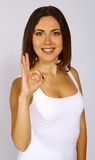 Young cute woman showing OK gesture. Portrait of young cute woman smiling and showing OK gesture Royalty Free Stock Photos