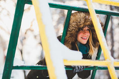 Young cute woman in the snow Stock Photography