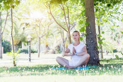 Young cute woman stretching in park Royalty Free Stock Photos