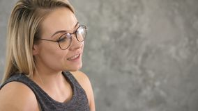 Young cute woman talking to someone. royalty free stock image