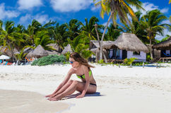 Young cute woman at tropical sandy beach during Caribbean vacation Royalty Free Stock Photo