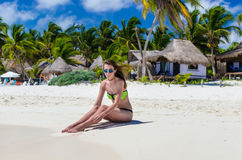 Young cute woman at tropical white sandy beach in the Caribbean sea Royalty Free Stock Photos