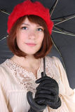 Young cute woman with umbrella. Young cute woman in red beret with umbrella Royalty Free Stock Image