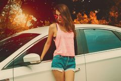 Young cutie girl in sunglasses posing outdoors royalty free stock images