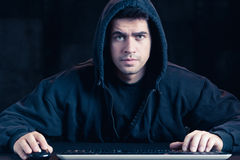 Young cyber warior in hoody Stock Image