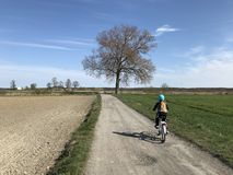 Young girl riding a bike in Polish countryside royalty free stock photos