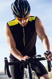 Young cyclist man setting timer on bicycle in sports gear. Stock Photography