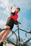 Young cyclist offering water royalty free stock images
