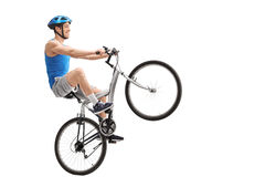 Young cyclist performing a wheelie Royalty Free Stock Photos