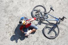 Young cyclist rest near bike Royalty Free Stock Photography