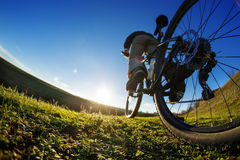 Young Cyclist riding on the Beautiful Meadow Trail on sunny day Stock Photo