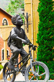 Young cyclist statue Stock Photos