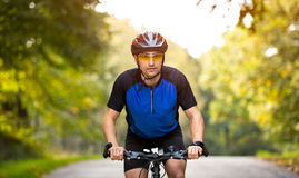 Young cyclists ride bike with helmet Royalty Free Stock Images