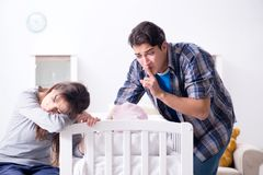 The young dad cannot stand baby crying. Young dad cannot stand baby crying stock photos